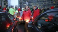 Belgian union representatives block one of the main thoroughfares in Brussels