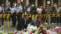 Tony Abbott lays flowers down