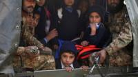 Children and soldiers in Pakistani army vehicle