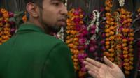 Pakistan school attack survivor Aqif Azeem shows BBC reporter faint blood stains on his school uniform