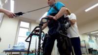 Man walking with a exoskeleton
