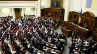 "Parliamentary deputies applaud after a renouncing of Ukraine's ""non-aligned"" status during a session of a parliament in Kiev"