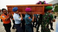 First coffin taken back to airport