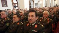 Afghan security forces listening to speech