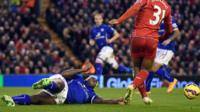 Leicester City defender Wes Morgan is penalised for handball against Liverpool