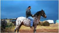 Shane Red Hawk on horseback
