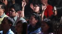 Members of Mawar Sharon church attend a prayer service for the relatives of lost loved ones aboard the AirAsia Flight 8501, in Surabaya, East Java, Indonesia Sunday, Jan. 4, 2015