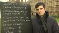 Alex Donohue from Ladbrokes with election odds written on a chalk board