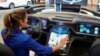 """A Hyundai Motor Co. hostess demonstrates an """"infortainment"""" car touchscreen information technology, during the 2015 International Consumer Electronics Show (CES) in Las Vegas, Nevada, USA, 05 January 2015"""
