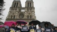 People in front of Notre Dame Cathedral