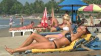 Sunbathing on beach in Goa