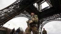 A French soldier patrols near the Eiffel Tower