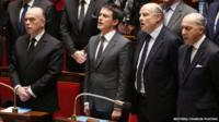 Members of France's National Assembly sing the national anthem, La Marseillaise, after holding a minute's silence for victims of Paris attacks