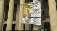 Banner showing Pope Francis