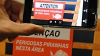 Google Translate translates a sign which reads Attention Dangerous piranhas in this area