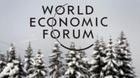 The logo of World Economic Forum (WEF) logo in front of snow-covered trees, file pic from 2012