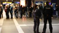 Police officers at the main Hauptbahnhof railway station in Berlin on 17 January 2015