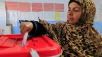 Tunisian woman casting vote