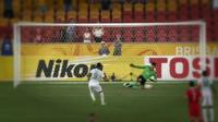 A ballboy helps Chinese goalkeeper Wang Dalei to save a penalty kick from Saudi Arabia's Naif Hazazi in China's 1-0 AFC Asian Cup win in Brisbane