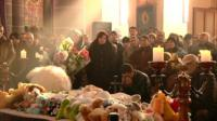 People attend the funeral of a baby in Armenia