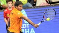 Rohan Bopanna, Indian tennis professional, returns a shot