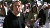 BBC reporter Sally Nabil walking alongside anti-Houthi protesters in the Yemeni capital Sanaa