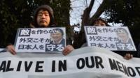 """People stage a silent rally for Japanese hostage Kenji Goto called """"Kenji, You will be alive in our memories"""""""