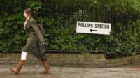 Woman walking in direction of polling station