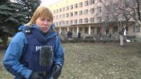The BBC's Olga Ivshina outside the hospital in Donetsk