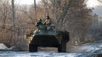 Ukrainian servicemen and armoured vehicle