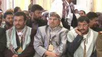Houthi men in the Presidential palace