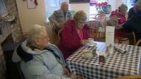 Pensioners having tea