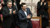 Prime Minister Alexis Tsipras applauding