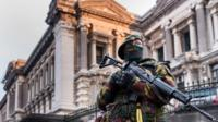 Belgian security officer stands guard near the Palace of Justice