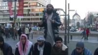 a muslim man preaching on a street in Belgium
