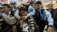 Police shout at protesters during a demonstration inside a shopping mall in Hong Kong