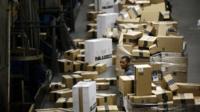 Employee sorting packages