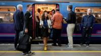 Commuters exit a train