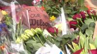 Tributes in Denmark to shooting victims