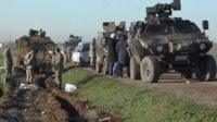 Turkish forces arrive back in Turkey following the evacuation