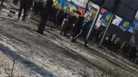 Footage of people running from the blast
