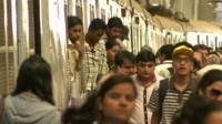 Passengers at one of India's busiest train stations in Mumbai