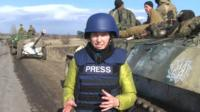 BBC reporter Anastasia Gribanova standing in front of Ukrainian army vehicle in Artemivsk, eastern Ukraine