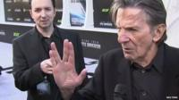 Leonard Nimoy at red carpet event making his famous 'Mr Spock' salute
