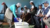 Woman casts ballot in Lesotho
