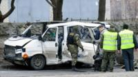 Wreckage of a minibus in Kharkiv
