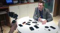 Spencer Kelly being filmed on a mobile phone