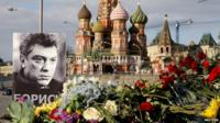 Portrait of Boris Nemtsov with floral tributes at the site where he was killed in Moscow