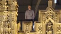 Man on roof of Parliament