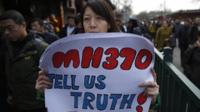 Woman holds MH370 sign in China